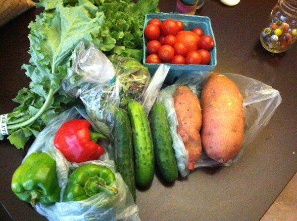 This week's haul: Roasted peppers, salad greens, cooking greens, tomatoes, cucumbers, sweet potatoes and peppers.