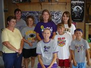 The Lancasters throw a haircut party in their garage. Joining Lancaster to celebrate her new look are her children, Maddy, second from right, and Cooper, right, and several of her closest friends. From left are Audean Paul, Kathie Wingert, Amy Kessinger, Becky Blaue and Amanda Paul.