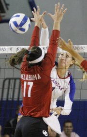 Kansas outside hitter Chelsea Albers (1) spikes the ball during the Jayhawks action against the Oklahoma Sooners Wednesday at the Horejsi Center.
