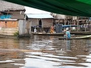 During the wet season in Belén, Peru, residents must canoe through waste-ridden waters to visit neighbors.