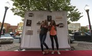 Kansas freshmen Meghan Saravanja, Junction City, and Hallie Holton, Seattle, Wash., strike a pose as a small section in the 800 block of Massachusetts Street turned into a makeshift red carpet as Downtown Lawrence Inc.'s Girls Night Downtown set up a photo booth Thursday evening. Donations from the event are going to help the Willow Domestic Violence Center.