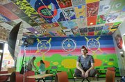 Mike Yoder/Journal-World Photo.Lance LeClair, Lawrence, has worked 3 years decorating and painting ceiling tiles and walls and the menu board inside Pizza Shuttle, 1601 W. 23rd St.