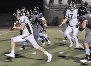 Free State's Stan Skwarlo (3) rumbles into the end zone to score in overtime Friday. Oct. 11, 2013 at SM North District Stadium.