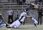Free State High's Lucas Werner (6) sacks SM East quarterback Christian Blessen in overtime for a loss of yards Friday. Oct. 11, 2013 at SM North District Stadium.
