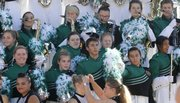 Members of the Lawrence Free State Marching Firebirds pose for a band photograph after competing Saturday in the 22nd annual Heart of America Marching Band Festival at Memorial Stadium.