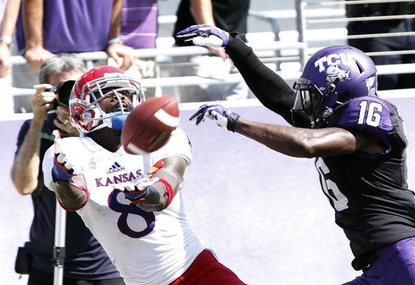 Kansas receiver Josh Ford (8) looks to catch a pass but behind TCU's Keivon Gamble (16) on Saturday, Oct. 12, 2013. KU lost, 27-17.