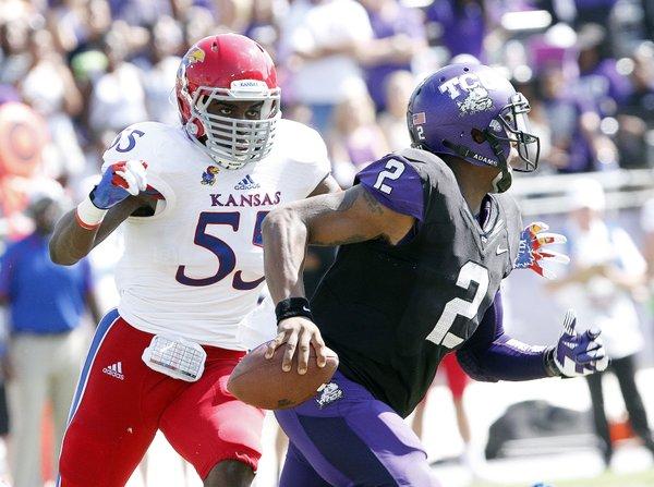 Kansas junior Michael Reynolds eyes TCU's quarterback  Trevone Boykin (2) on Saturday, Oct. 12, 2013, during the teams' game in Fort Worth, Texas.