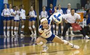 Kansas defensive specialist Jaime Mathieu stretches as she attempts to make a dig during Kansas' volleyball match against Texas, Saturday at the Horejsi Center. The Jayhawks fell to the Longhorns in four sets, 3-1.