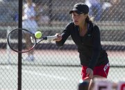 Lawrence High's Brooke Braman makes a return during doubles action at a Class 6A regional tennis tournament, Saturday, Oct. 12, 2013, at Lawrence High.