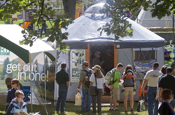 A Yurt draws a crowd at the Colorado Yurt Company booth during the Mother Earth News fair Saturday in Watson Park. The fair continues Sunday with many demonstrations and hands-on workshops.