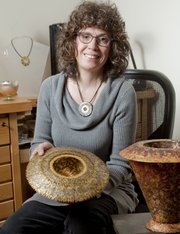 Gina Westergard, associate professor of metalsmithing/jewelry at Kansas University, was voted this year's Lawrence ArtWalk Featured Artist Award. Westergard's current body of work is comprised of jewelry as well as funerary urns and reliquaries, which are functional objects that have great significance to her.