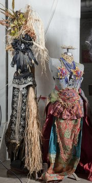 Mike Yoder/Journal-World Photo.The Lawrence-based cabaret/comedy troupe Foxy by Proxy, uses a variety of costumes in their performance, many of which they hand make. Shown here is a Voodoo Lady outfit at left and a Burlesque costume at right. The group performs Nov. 1 at the Granada.