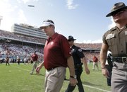 Oklahoma coach Bob Stoops walks off the field after the Sooners' 36-20 loss to Texas in the Red River Rivalry on Saturday in Dallas. OU — 14-0 under Stoops in games played after the UT game — will play Saturday at Kansas.