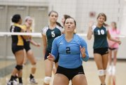 Free State junior libero Paige Corcoran reacts after narrowly missing a ball that scored a point for St. Teresa's Academy on Tuesday, Oct. 15, 2013, at FSHS.