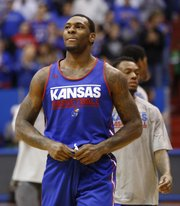 Kansas forward Tarik Black smiles as he looks up into the stands to see about ten thousand fans during an open-practice scrimmage on Saturday, Oct. 19, 2013 at Allen Fieldhouse.