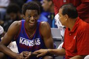 Kansas forward Andrew Wiggins laughs with assistant coach Kurtis Townsend during an open-practice scrimmage on Saturday, Oct. 19, 2013 at Allen Fieldhouse.
