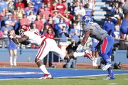 Kansas cornerback Dexter McDonald watches as Oklahoma receiver Jaz Reynolds dives into the endzone for a touchdown during the second quarter on Saturday, Oct. 19, 2013 at Memorial Stadium.