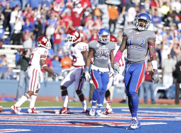 Kansas cornerback Dexter McDonald turns back to the bench after giving up a touchdown to Oklahoma receiver Jaz Reynolds during the second quarter on Saturday, Oct. 19, 2013 at Memorial Stadium.