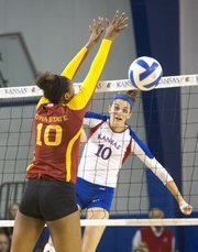 Kansas' Tayler Soucie hits a spike past Iowa State's Victoria Hurtt during their volleyball match Wednesday evening at the Horejsi Center.