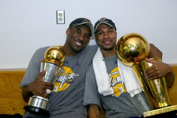 Derek Fisher holds the NBA championship trophy and hangs with Kobe Bryant and his Finals MVP trophy.