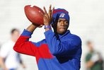 Kansas quarterback Montell Cozart throws during warmups prior to kickoff against Baylor on Saturday, Oct. 26, 2013.