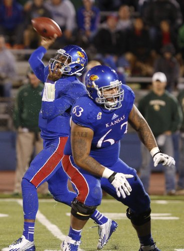 Kansas quarterback Montell Cozart throws as he gets protection from offensive lineman Ngalu Fusimalohi during the second quarter on Saturday, Oct. 26, 2013.