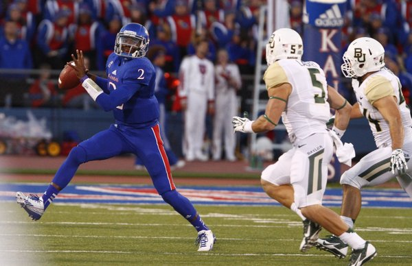 Kansas backup quarterback Montell Cozart breaks out of the pocket as the Baylor defense closes in during the first quarter on Saturday, Oct. 26, 2013.
