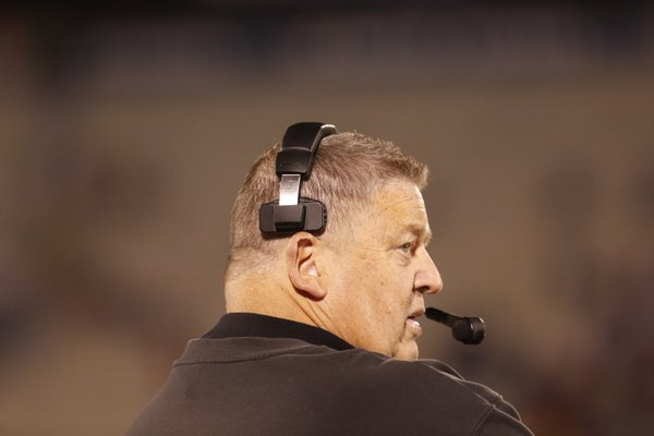 Kansas head coach Charlie Weis glances at the scoreboard in the third quarter against Baylor.