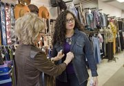 Cheryl Eckles at Saffee's, left, works with reporter Nadia Imafidon on selecting clothes during a style consulting program called 10-10-10, which helps women find the clothes appropriate to body type.