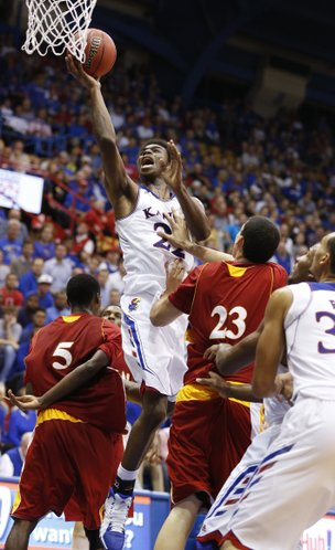 Kansas guard Andrew Wiggins slashes to the bucket between Pittsburg State players Devon Branch (5) and Alex Williams (23) during the second half of an exhibition game on Tuesday, Oct. 29, 2013 at Allen Fieldhouse.
