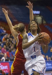 Kansas guard Lamaria Cole (1) blows past a Pittsburg State player on her way to an easy layup during their exhibition game Wednesday at Allen Fieldhouse.