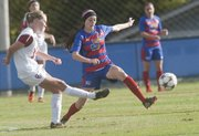 Kansas sophomore forward Courtney Dickerson defends a pass from Oklahoma's Kathryn Watson on Friday, Nov. 1, 2013, at Jayhawk Soccer Complex.
