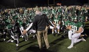 Free State High coach Bob Lisher addresses the Firebirds after a 28-10 victory over Lawrence High in the City Showdown on Friday, Nov. 1, 2013, at FSHS.