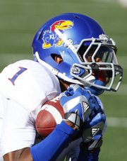 Kansas receiver Rod Coleman pulls in a catch as he falls to the ground against Texas during the second quarter on Saturday, Nov. 2, 2013 at Darrell K. Royal Stadium in Austin, Texas.