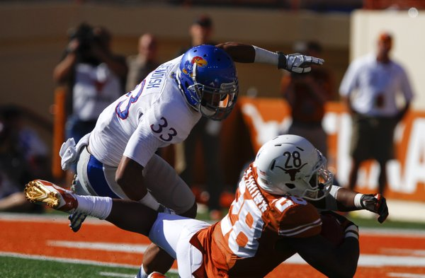 Texas running back Malcolm Brown falls just short of the endzone as Kansas safety Cassius Sendish comes in to cover during the second quarter on Saturday, Nov. 2, 2013 at Darrell K. Royal Stadium in Austin, Texas.