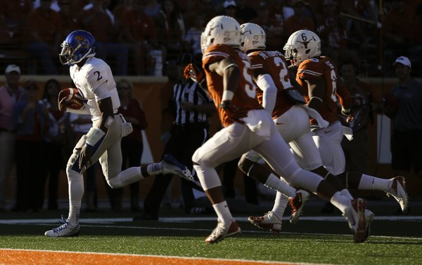 Kansas backup quarterback Montell Cozart runs in a touchdown against Texas during the fourth quarter on Saturday, Nov. 2, 2013 at Darrell K. Royal Stadium in Austin, Texas.