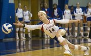 Kansas' Jaime Mathieu stretches for the ball during Kansas' volleyball match against West Virginia, Wednesday, Nov. 6, 2013, at Horejsi Center.