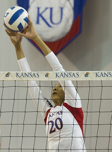 Kansas' Catherine Carmichael makes a block during Kansas' volleyball match against West Virginia, Wednesday, Nov. 6, 2013, at Horejsi Center.
