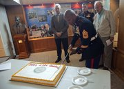 Marines are celebrating the 238th birthday of the Corps. David Hakim Jr., a U.S. Marine from Cleveland, Ohio, cuts the cake. Looking on, from left, are as Lt. Col. (ret.) Perry Puccetti, Edward Stimac, 29, Kansas City, Kan., and James Stokes, 90, of Lawrence.