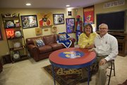 Beth and Marshall Kelley's Jayhawk-themed basement makes a good backdrop for game-watching (unless they're at Allen Fieldhouse) or family game nights. Almost every item comes with a memory, the Lawrence couple said.