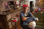 Pat Sullivan's Jayhawk memorabilia fills his downstairs recreation room, bar and even a bathroom. He has memorabilia from a number of KU sports, and lots of tickets to help him remember big games.