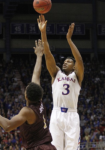 Kansas guard Andrew White III (3) launches a three-point attempt during the Jayhawks' win against Louisiana-Monroe, Friday, November, 8, 2013 at Allen Fieldhouse.