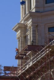 Workmen remove one of the steel beams used for support during renovation of the  Kansas Statehouse.