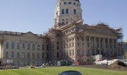 The multi-phase Kansas Statehouse restoration, currently underway, includes restoration of the first through fifth floors, rehabilitation/expansion of the basement, complete exterior masonry restoration, copper roof and copper dome restoration.