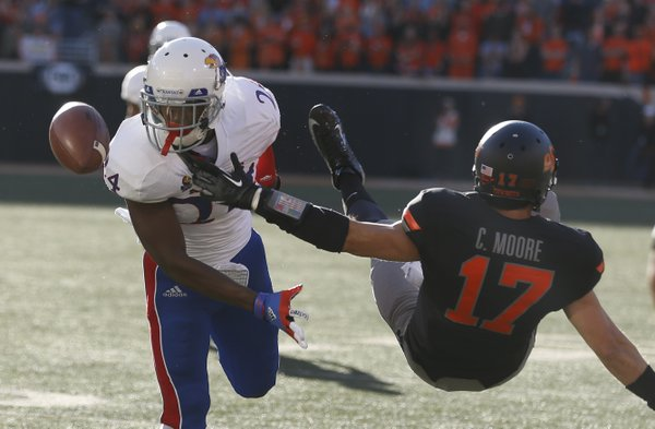 Kansas cornerback JaCorey Shepherd knocks away a pass to Oklahoma State receiver Charlie Moore as Moore falls to the turf during the first quarter on Saturday, Nov. 9, 2013 at Boone Pickens Stadium in Stillwater, Oklahoma.