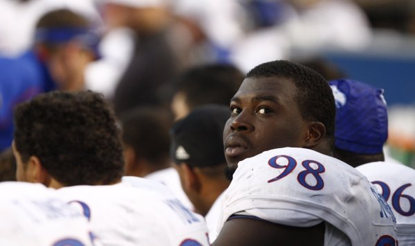 Kansas defensive lineman Keon Stowers looks up at the scoreboard during the third quarter on Saturday, Nov. 9, 2013 at Boone Pickens Stadium in Stillwater, Oklahoma.
