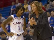 Kansas head coach Bonnie Henrickson pulls guard Lamaria Cole aside during a stoppage in play during Kansas' season opening game against Oral Roberts Sunday afternoon at Allen Fieldhouse. The Jayhawks won, 84-62.