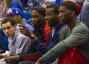 Kansas recruit Cliff Alexander, second from right, hangs out with members of the Kansas men's team Sunday afternoon at the Kansas women's season opening basketball game against Oral Roberts. Alexander's girlfriend plays for the women's team.