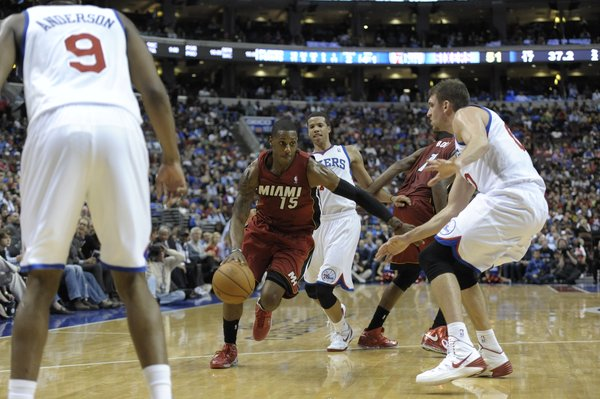 Miami Heat's Mario Chalmers (15) is seen during the first half of an NBA basketball game against the Philadelphia 76ers on Wednesday, Oct. 30, 2013, in Philadelphia. (AP Photo/Michael Perez)