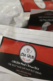 Gary and Angie Rexroad, along with their dog Rex, all from Lawrence, have developed a line of dog food called Love Grub. The food is available at Pawsh Wash, Lawrence Feed and Farm, Lucky Paws, both Hy-Vee locations and Checkers.